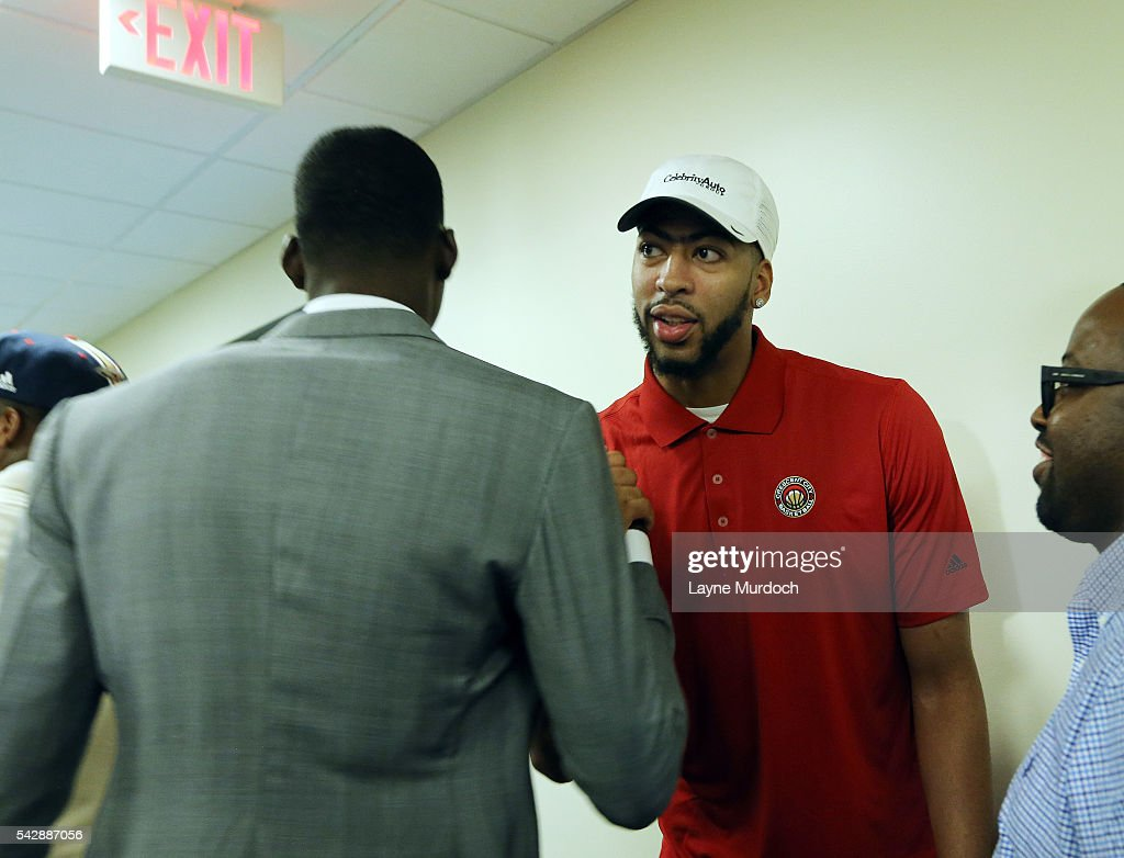New Orleans Pelicans 2016 Draft selection <a gi-track='captionPersonalityLinkClicked' href=/galleries/search?phrase=Cheick+Diallo+-+Basketball+Player&family=editorial&specificpeople=14242656 ng-click='$event.stopPropagation()'>Cheick Diallo</a> shakes hands with <a gi-track='captionPersonalityLinkClicked' href=/galleries/search?phrase=Anthony+Davis+-+Basketball+Player&family=editorial&specificpeople=9539354 ng-click='$event.stopPropagation()'>Anthony Davis</a> #23 of the New Orleans Pelicans on June 24, 2016 at the New Orleans Practice Facility in New Orleans, Louisiana.