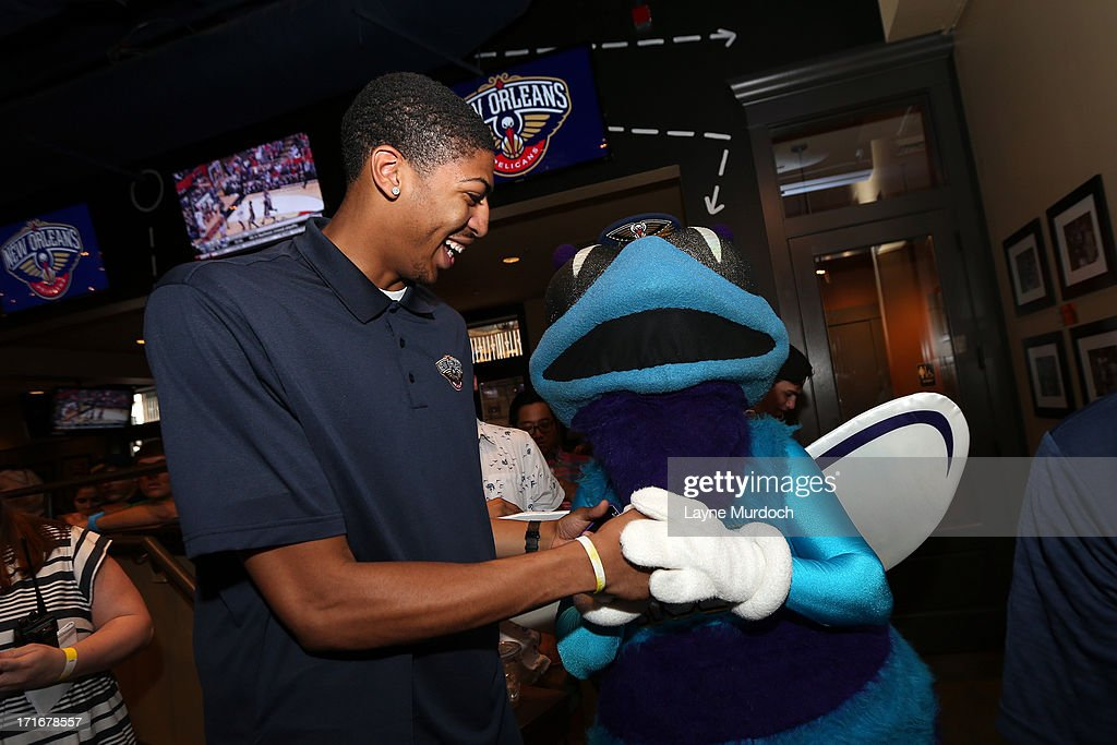 New Orleans Pelicans forward Anthony Davis says hello to the old Hornets mascot as he attends a 2013 NBA draft party on June 27, 2013 at the Manning's Restaurant in New Orleans, Louisiana.