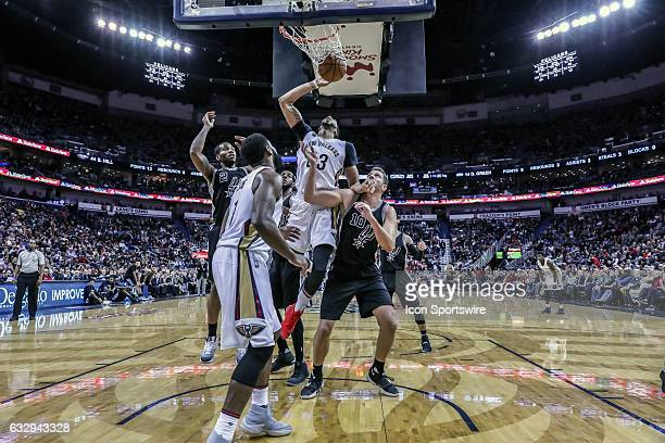 New Orleans Pelicans forward Anthony Davis taps the ball in against San Antonio Spurs forward David Lee during the game between the New Orleans...