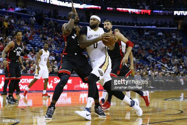 New Orleans Pelicans forward DeMarcus Cousins drives against Toronto Raptors forward Serge Ibaka during the first half of a game at the Smoothie King...
