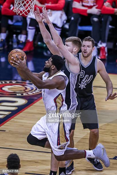 New Orleans Pelicans guard Tyreke Evans drives to the basket against San Antonio Spurs forward David Lee during the game between the New Orleans...