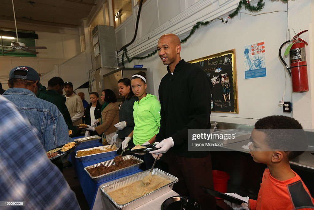 New Orleans Pelicans head coach Monty Williams along with his family and other member of the Pelicans organization feed the homeless on December 12...