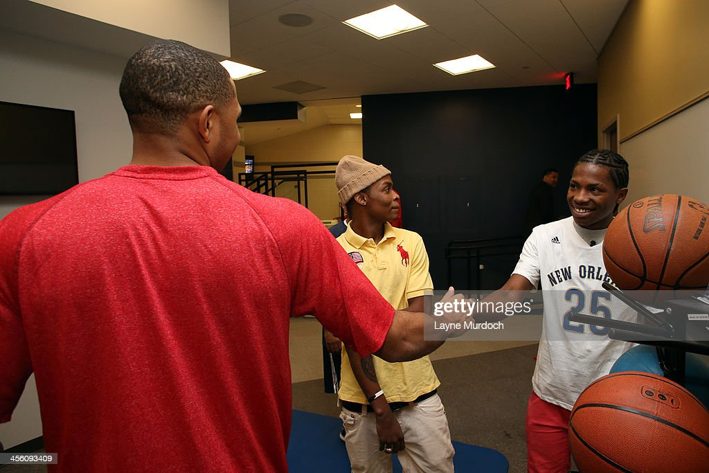 New Orleans Pelicans head coach Monty Williams helps make the wish of 17-year-old Zevon Franklin (Austin Rivers #25 shirt) of Brooklyn, New York come true as he gives the Make-a-Wish recipient a personal tour of the new Pelicans locker room and introduces him to Pelicans guard Eric Gordon on December 11, 2013 at the New Orleans Arena in New Orleans, Louisiana. Zevon is having his wish of meeting Austin Rivers granted and spends time with his favorite player with his best friend Anthony Garcia.