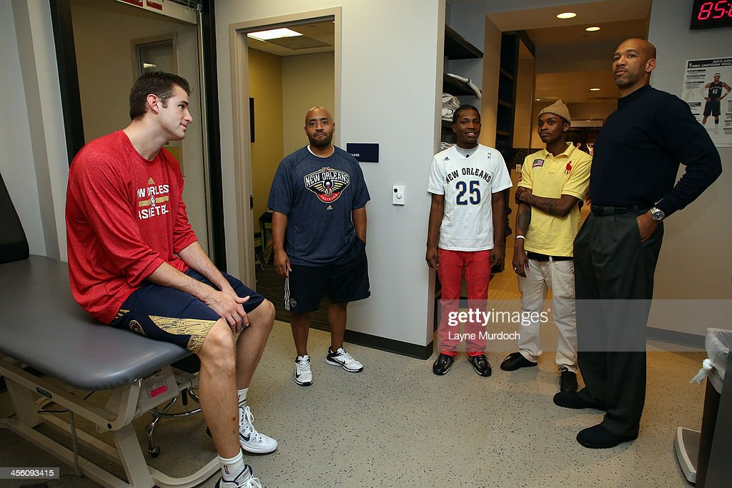 New Orleans Pelicans head coach Monty Williams helps make the wish of 17-year-old Zevon Franklin (Austin Rivers #25 shirt) of Brooklyn, New York come true as he gives the Make-a-Wish recipient a personal tour of the new Pelicans locker room and introduces him to Pelicans forward Jason Smith on December 11, 2013 at the New Orleans Arena in New Orleans, Louisiana. Zevon is having his wish of meeting Austin Rivers granted and spends time with his favorite player with his best friend Anthony Garcia.