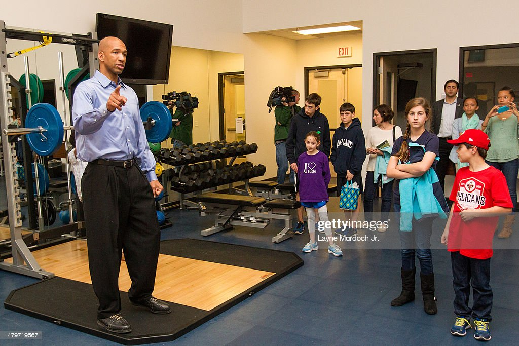 New Orleans Pelicans head coach Monty Williams shows St Jude patients and their family the new practice facility on March 17 2014 at the New Orleans...