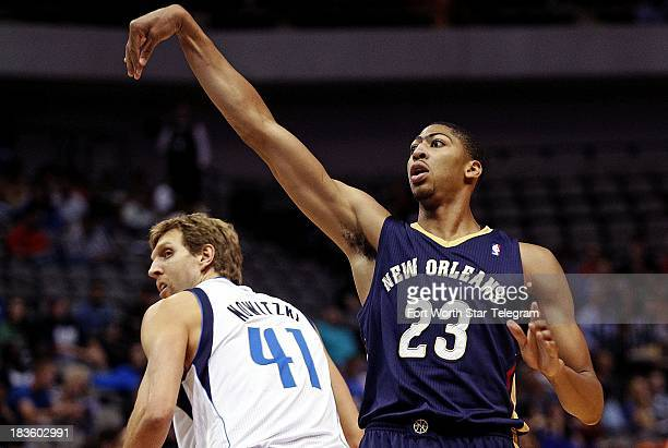 New Orleans Pelicans power forward Anthony Davis launches a shot as Dallas Mavericks power forward Dirk Nowitzki looks on in the first half of a...