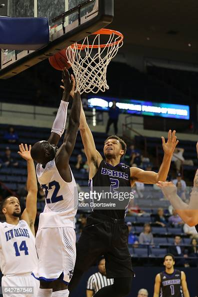 New Orleans Privateers forward Makur Puou defends Central Arkansas Bears forward Ethan Lee as he shoots during a game between Central Arkansas and...