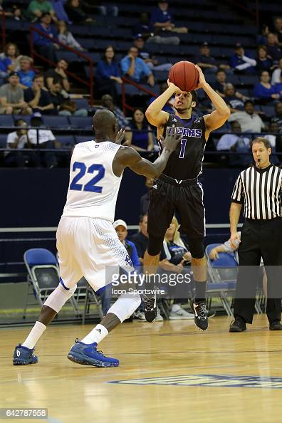 New Orleans Privateers forward Makur Puou defends Central Arkansas Bears guard Jordan Howard as he shoots during a game between Central Arkansas and...