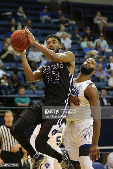 New Orleans Privateers guard Michael Zeno defends Central Arkansas Bears guard Derreck Brooks as he shoots during a game between Central Arkansas and...
