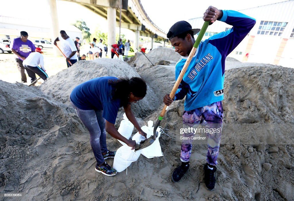 New Orleans residents fill sand bags in preparation for Tropical Storm Nate on October 6, 2017 in New Orleans, Louisiana. Nate is expected to become a Catagory 1 Hurricane as it enters the Gulf of Mexico this weekend.