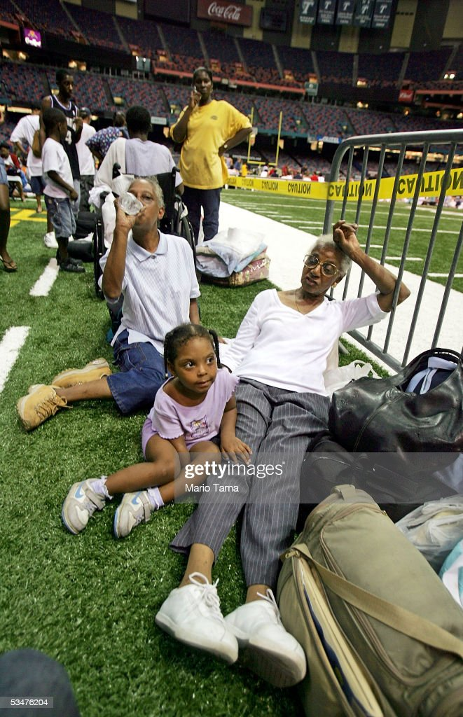 New Orleans residents, who did not want to be identified, sit in the Superdome which is being used as an emergency shelter before the arrival of Hurricane Katrina August 28, 2005 in New Orleans, Louisiana. Hurricane Katrina has sustained winds of 175 mph and is expected to make landfall in the Gulf Coast as early as August 29. Katrina killed at least seven when it moved through Miami-Dade County in Florida.