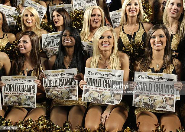 New Orleans Saints cheerleaders hold papers celebrating the Saints win over the Indianapolis Colts during Super Bowl XLIV on February 7 2010 at Sun...