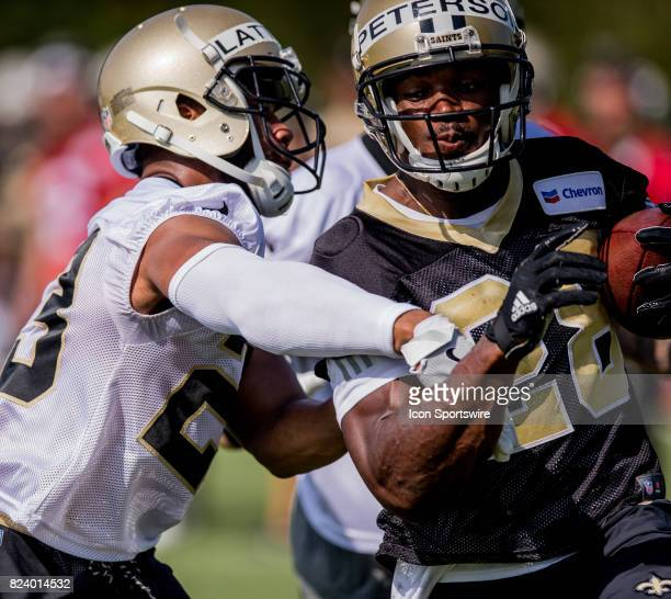 New Orleans Saints cornerback Marshon Lattimore tackles running back Adrian Peterson during Training Camp on July 28 at the Ochsner Sports...