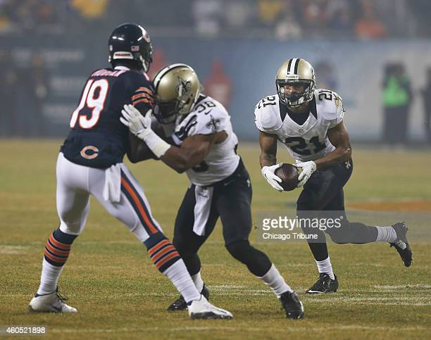 New Orleans Saints cornerback Patrick Robinson intercepts a ball intended for Chicago Bears tight end Martellus Bennett during the first quarter on...