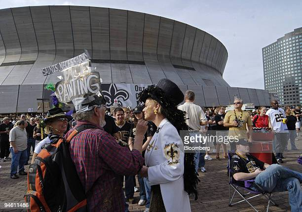New Orleans Saints fans get their faces painted outside the SuperDome prior to the NFC Playoff game between the Saints and the Philadelphia Eagles in...