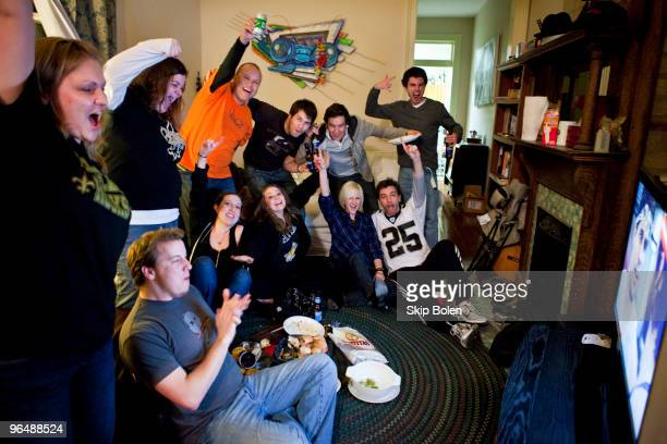 New Orleans Saints fans watching the final minutes of Super Bowl XLIV with the anticipation of a New Orleans Saints win at a MidCity home on February...