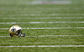 New Orleans Saints helmet sits on the field before the start of the game against the Carolina Panthers at MercedesBenz Superdome on December 7 2014...