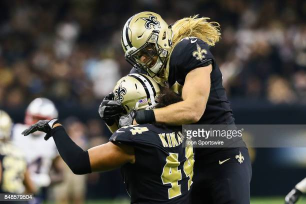 New Orleans Saints linebacker Alex Anzalone celebrates with New Orleans Saints outside linebacker Hau'oli Kikaha after a sack during the game between...