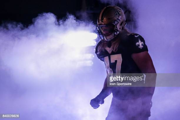 New Orleans Saints linebacker Alex Anzalone runs out the tunnel during the game between the New Orleans Saints and the Houston Texans on August 26...