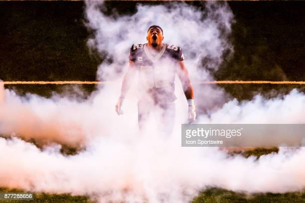 New Orleans Saints linebacker Craig Robertson runs out through the smoke against Washington Redskins on November 19 2017 at the MercedesBenz...