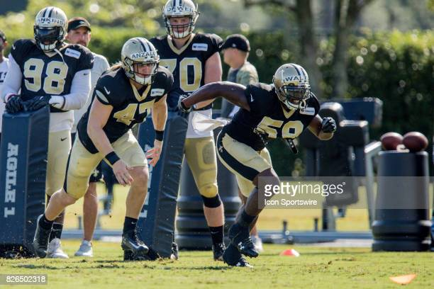New Orleans Saints outside linebacker Jonathan Walton races linebacker Alex Anzalone during Training Camp on August 04 at the Ochsner Sports...