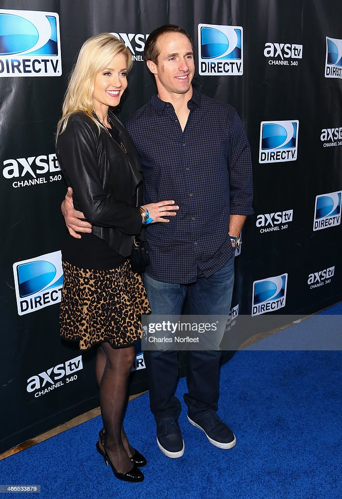 New Orleans Saints quarterback Drew Brees (L) and his wife Brittany Brees attend the DirecTV Super Saturday Night at Pier 40 on February 1, 2014 in New York City.