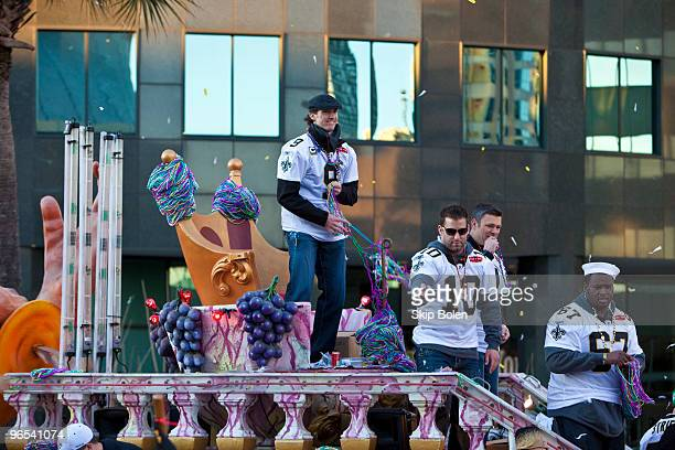 New Orleans Saints Quarterback Drew Brees and teammates celebrate during the New Orleans Saints Super Bowl XLIV Victory Parade as they ride past the...
