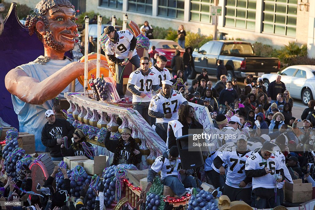 New Orleans Saints Quarterback Drew Brees #9 and teammates celebrate during the New Orleans Saints Super Bowl XLIV Victory Parade as they ride past the Louisiana Superdome on February 9, 2010 in New Orleans, Louisiana.