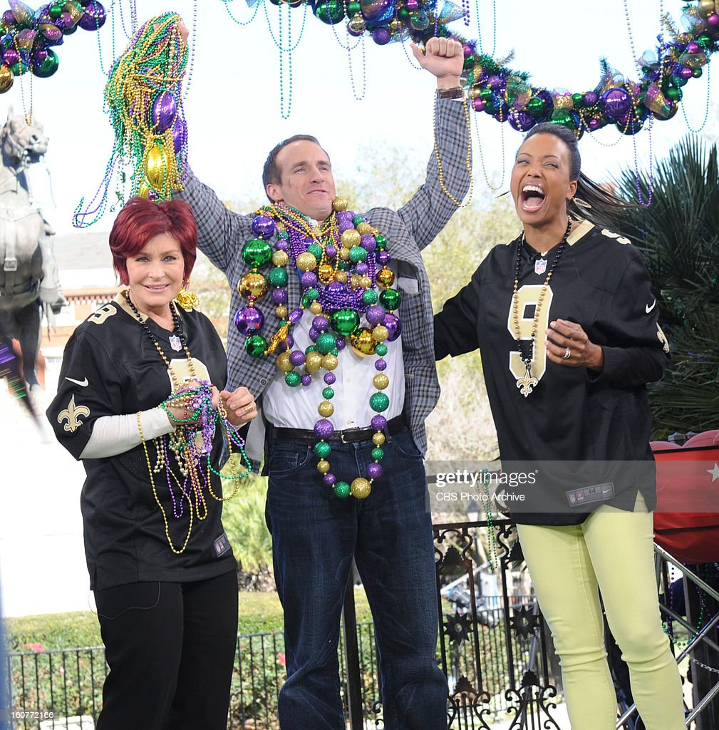 New Orleans Saints quarterback Drew Brees joins the ladies of THE TALK live on location in New Orleans as a special guest co-host, Friday, February 01, 2013. All week THE TALK broadcasts live from CBS Super Bowl Park at Jackson Square in the heart of the historic French Quarter in New Orleans leading up to Super Bowl XLVII airing on the CBS Television Network. Sharon Osbourne, from left, Drew Brees and Aisha Tyler, shown.