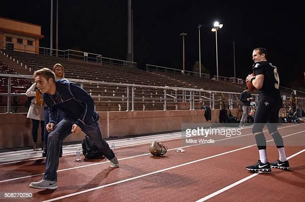 New Orleans Saints quarterback Drew Brees throws a pass to a Verizon #Minute50 winner at Kezar Stadium on February 3 2016 in San Francisco California