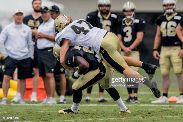 New Orleans Saints running back Adrian Peterson ducks to flip linebacker Alex Anzalone off of him during Training Camp on July 29 at the Ochsner...