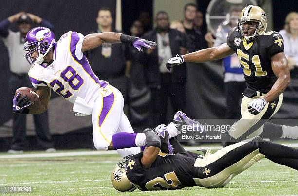 New Orleans Saints safety Darren sharper tackles Minnesota Vikings running back Adrian Peterson during the first quarter of the NFC Championship The...