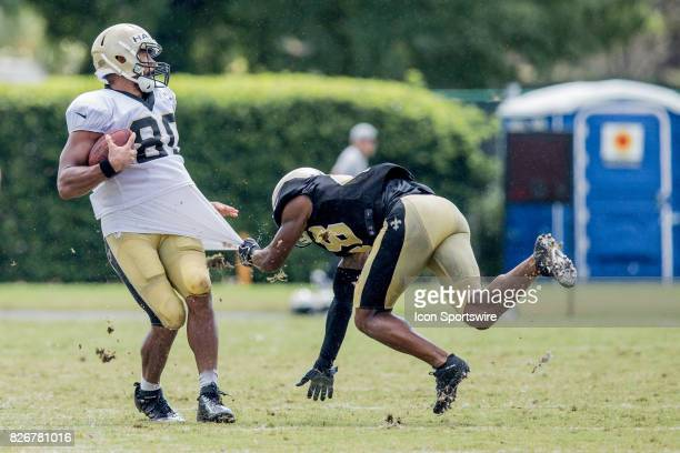 New Orleans Saints tight end Clay Harbor has his jersey pulled by strong safety Vonn Bell during Training Camp on August 05 at the Ochsner Sports...