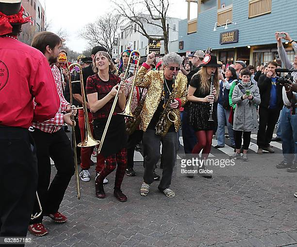 New Orleans style brass band parades through Davis Square in Somerville MA to mark Johnny D's last day of business on Mar 13 2016