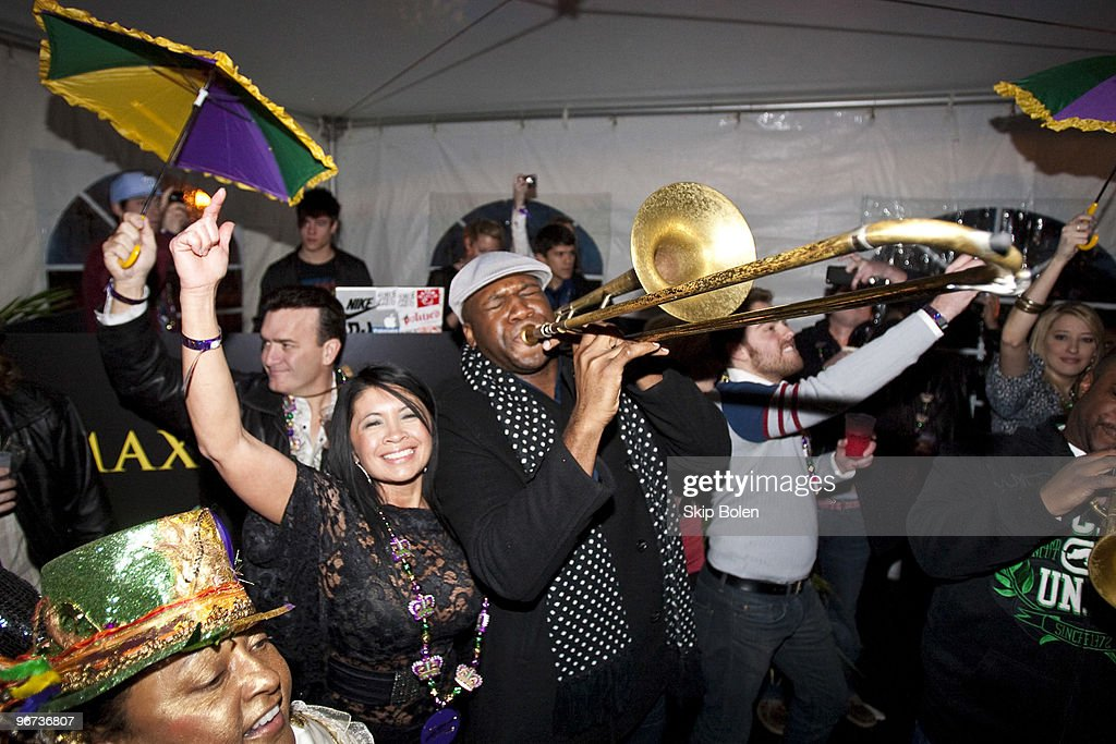 New Orleans trombone player Big Sam of Big Sam's Funky Nation plays to the partying crowds as they parade and second line at Maxim's Mega Mansion at Buckner Mansion on February 15, 2010 in New Orleans, Louisiana.