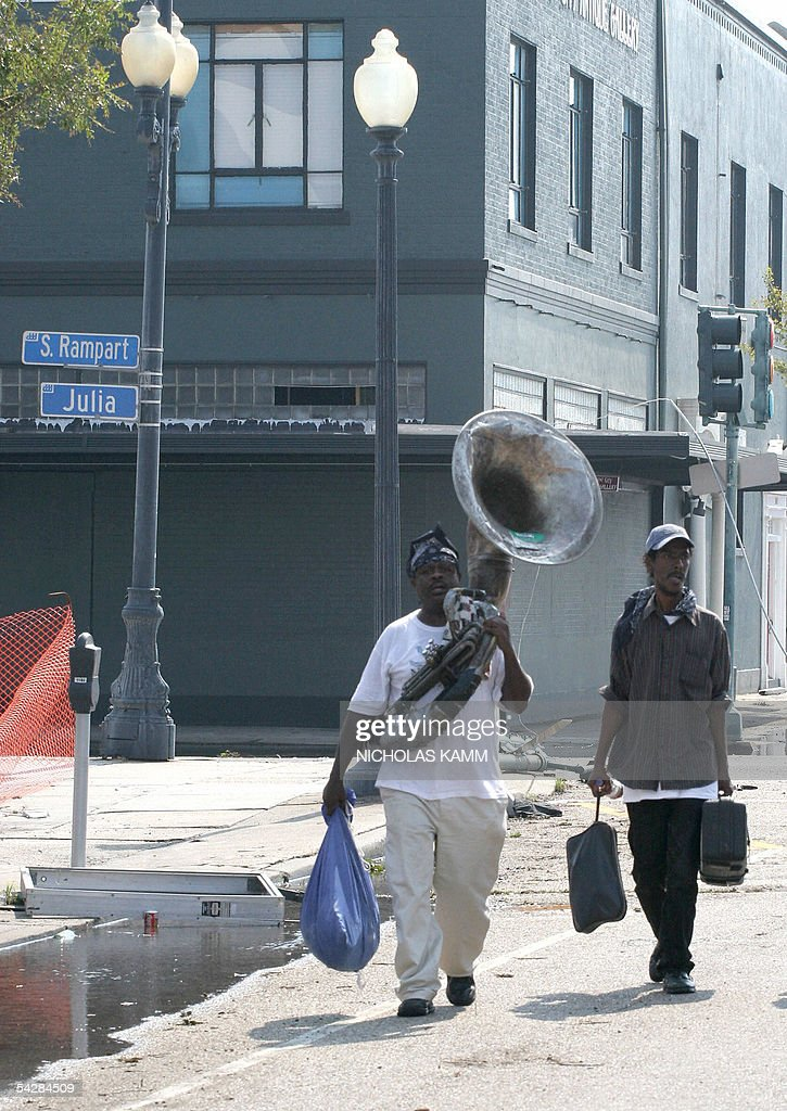 A musician carries his tuba in New Orleans 02 September 2005. Evacuations finally got into full swing five days after Hurricane Katrina hit the city. AFP PHOTO/Nicholas KAMM