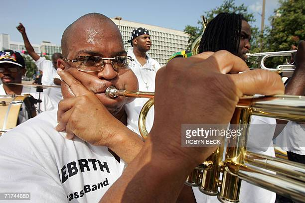 Derrick Shezbi blows his horn as he marches with the Rebirth Brass Band in the 'One New Orleans' jazz funeral procession 29 August 2006 in New...