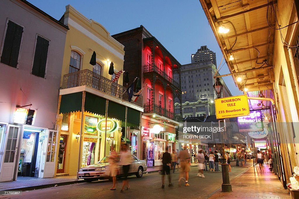 Dusk falls over Bourbon Street in the French Quarter of New Orleans 11 July 2006 almost one year after Hurricane Katrina devastated the city For...