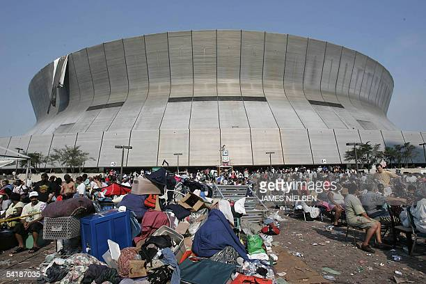 Hurricane Katrina survivors wait outside the Superdome and Convetion Center in New Orleans 02 September 2005 The New Orleans sports arena that housed...