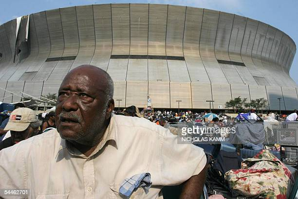 John Riley suffering from diabetes sits outside the Superdome in New Orleans 03 September waiting to be evacuated six days after hurricane Katrina...