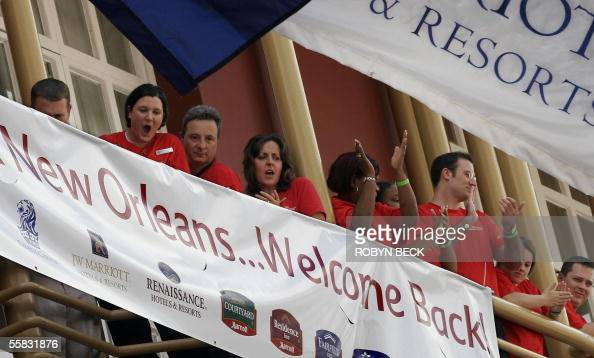 Marriott Hotel employees cheer during a ceremony to mark the reopening of the hotel on Canal Street in New Orleans Business owners and residents are...