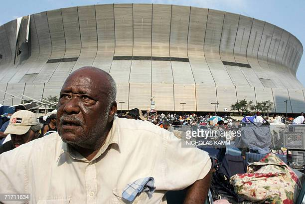 This 03 September 2005 file photo shows John Riley who was suffering from diabetes sitting outside the Superdome in New Orleans waiting to be...