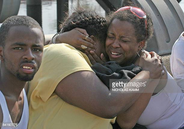 Two stranded women hug each eather and cry as they wait for a US army helicopter to land on an overpass near the Superdome in New Orleans Louisiana...
