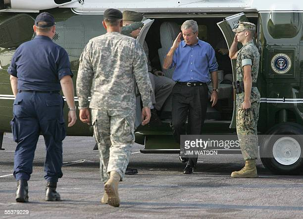 US President George W Bush salutes as he arrives onboard USS Iwo Jima 11 September 2005 in New Orleans Bush facing his worst ever poll numbers and...