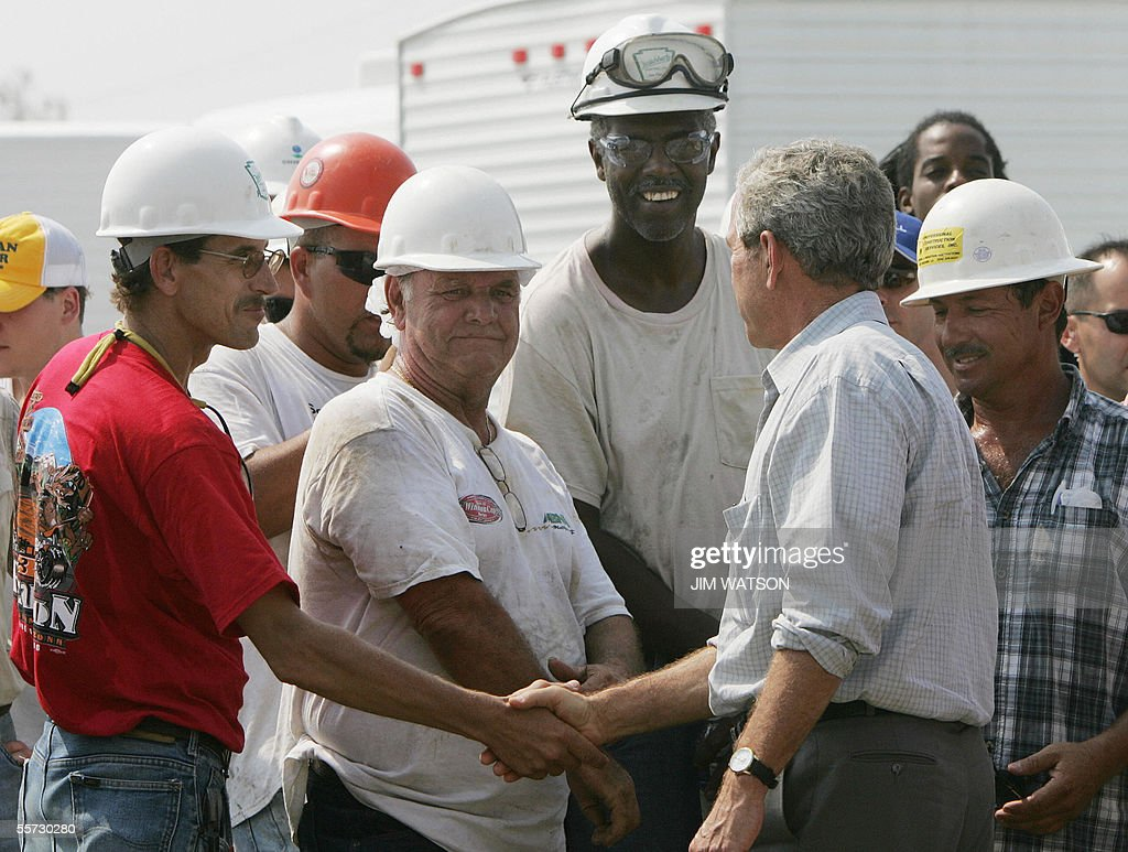 us president george w bush 2nd r shak pictures getty images us president george w bush 2nd r shakes hands workers from the