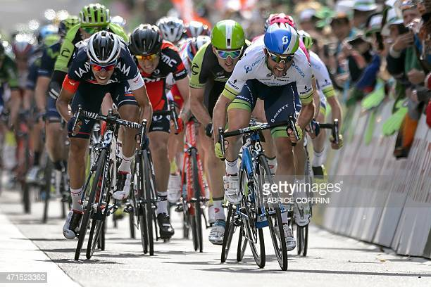 New overall leader Swiss Michael Albasini runs the sprint on his way to win the second stage 1681 km between Apples and SaintImier at the Tour de...