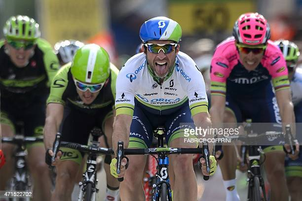 New overall leader Swiss Michael Albasini shows his tongue after winning the second stage 1681 km between Apples and SaintImier at the Tour de...