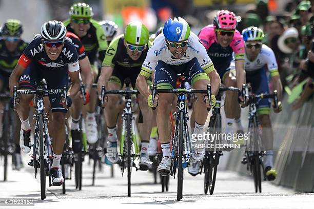 New overall leader Swiss Michael Albasini shows his tongue during the sprint on his way to win the second stage 1681 km between Apples and SaintImier...
