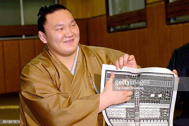 New ozeki Hakuho points his name as the new ranking is announced ahead of the Grand Sumo Summer Tournament at Miyagino Stable on April 24 2006 in...