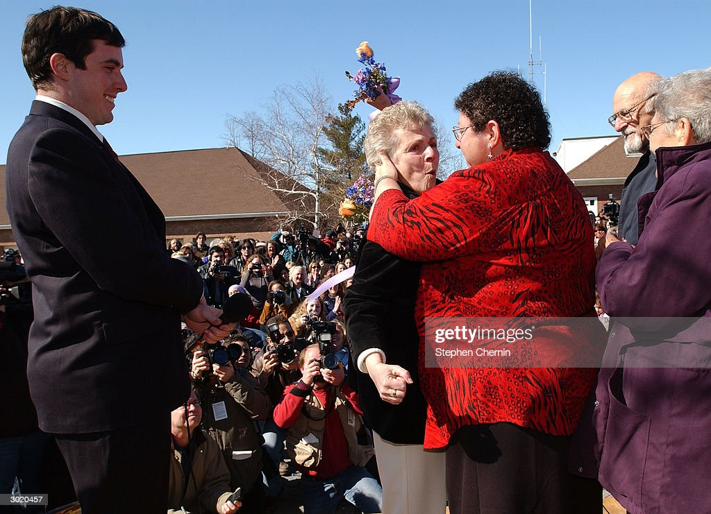 New Paltz Mayor Jason West watches as Joanne Still embraces her partner Mary Maendola after being married outside village hall February 27 2004 in...